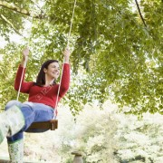 Woman swinging on swing